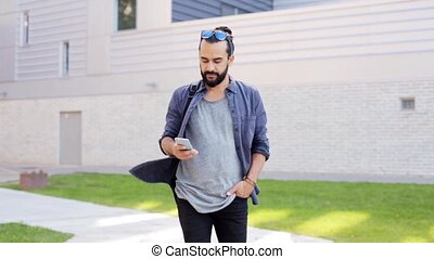 man with backpack calling on smartphone in city 44 - travel,...