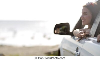 happy teenage girls or women in car at seaside 3 - summer...