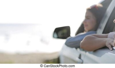 happy teenage girls or women in car at seaside 2 - summer...