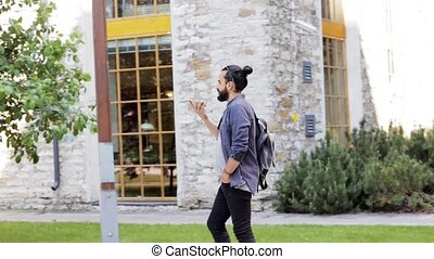 man with backpack calling on smartphone in city 37 - travel,...