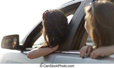 happy teenage girls or women in car at seaside 5