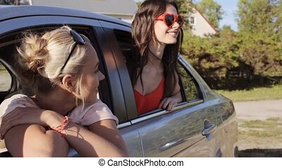 happy teenage girls or women in car at seaside 28 - summer...