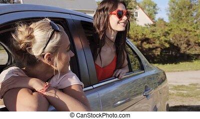 happy teenage girls or women in car at seaside 28 - summer...