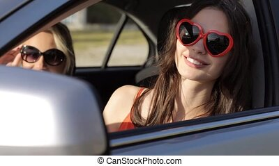 happy teenage girls or women in car at seaside 8 - summer...