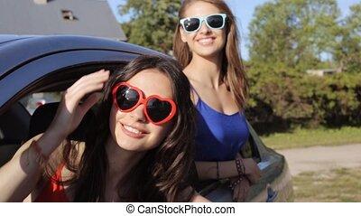 happy teenage girls or women in car at seaside 25 - summer...