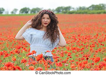 Young woman on poppy field - Young woman with a circlet of...