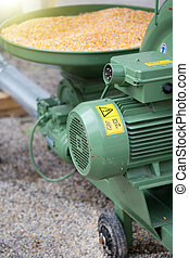 Corn grinding mill - Close up of grinding mill and container...