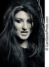 Scary evil woman in the dark - Portrait of young stylisn...