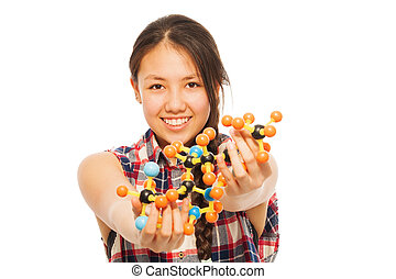 Asian researcher analyzing a molecular model - Young Asian...