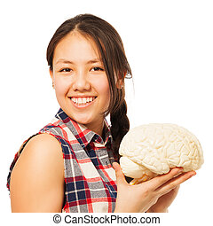 Asian 15 years old girl holding cerebrum model - Cute Asian...