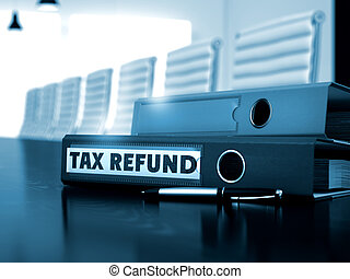 Tax Refund on Office Binder. Blurred Image. - Tax Refund....