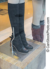 Woman dressed mannequins  In Fashion Shop .