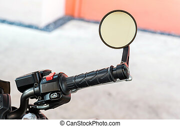 handle and rear view mirror of motorcycle - Closeup to...