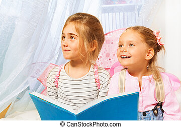 Little beautiful pixies reading the fairy-tale - Two little...