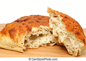 Artisan Bread - A square loaf of artisan bread with a corner...