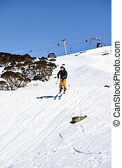 Skier racing in Ski Cross Course - Skier racing and jumping...