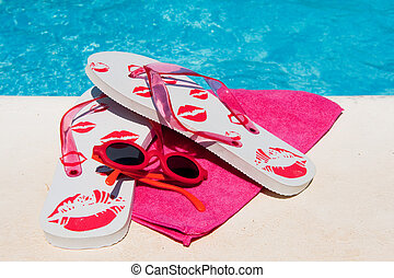 Flip flops near the swimming pool