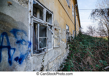 dilapidated house - dilapidated overgrown house from a...