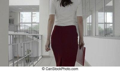 Business woman walks in office