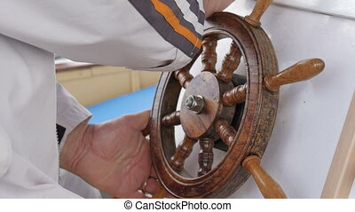Steering controls yacht - The navigator at the helm of the...
