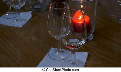 Red wine is poured into a glass
