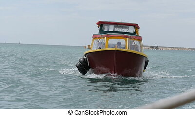 A small boat bobs on the waves HD