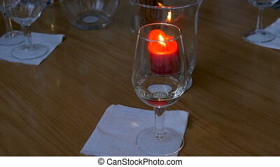 Two glasses of white wine on the background of candles