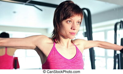 Woman working out at the gym - Woman training with...