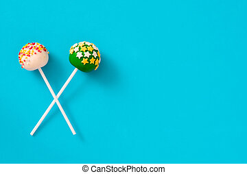Cake pops on blue background