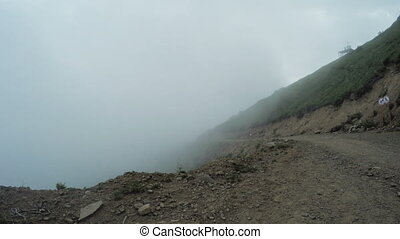 Mountains with thick fog - Tightened fog and road down...