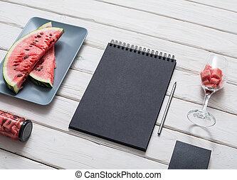 Sketchbook on kitchen table - Black sketchbook on kitchen...