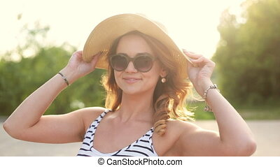 Girl wears sunglasses - A portrait of a beautiful young...