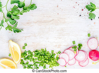 White wooden kitchen table background with healthy cooking...