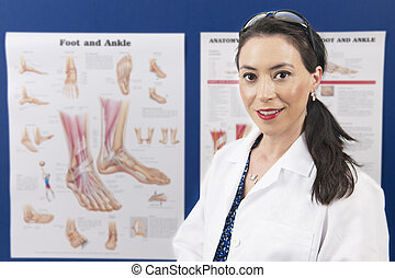 Podiatrist - An attractive podiatrist happily looking at the...
