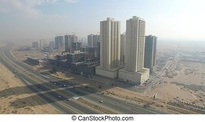 Cityscape of Ajman with modern buildings aerial top view and...