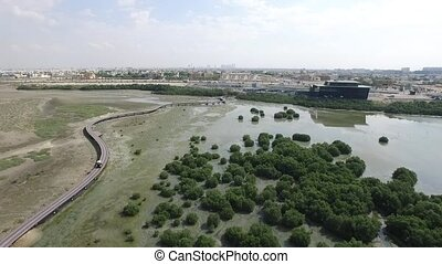 Cityscape of Ajman with golf fields aerial top view