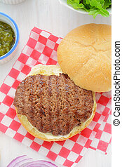 Grilled hamburger with condiments closeup - Grilled beef...