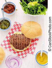 Grilled hamburger with condiments - Grilled beef hamburger...