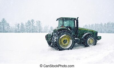 Tractor In Field In Snowstorm