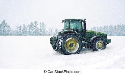 Tractor In Field In Snowstorm - Tractor in field in heavy...