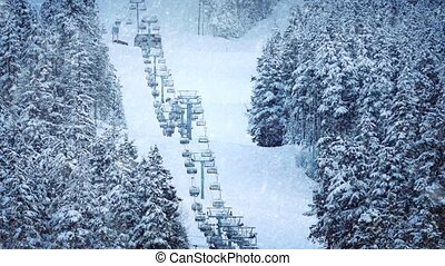 Chairlift On Mountain In Snowfall