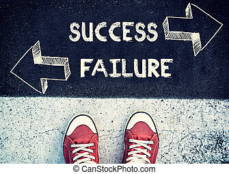 Failure and success - Student standing above the sign for...