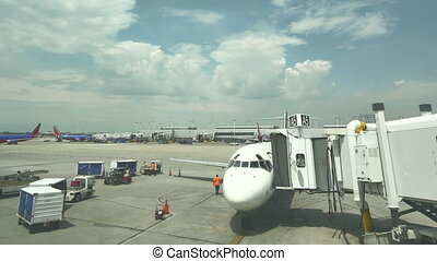 Commercial Airplane on the Gate at Midway Airport in...