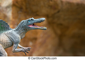 gris, spinosaurus, juguete, en, frente, de, roca,...