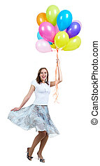 Excitement - Pretty young woman with colorful balloons...