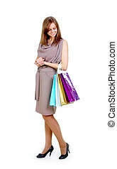 Happy shopper - Happy female with bags looking at them over...