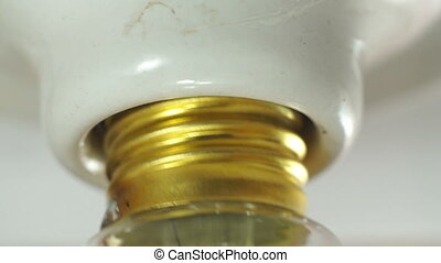 Light Bulb Screw In Macro - Close up macro shot of the...