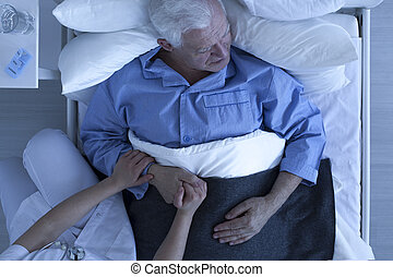 Doctor or nurse holding hand of senior patient - Doctor or...