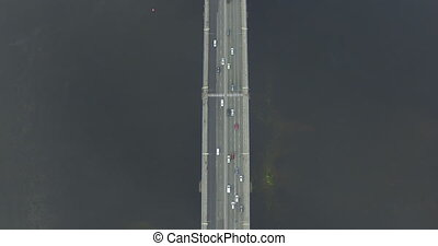 Traffic on the bridge of a city aerial view