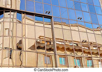 Glass facade - reflection of stone facade on modern glass...